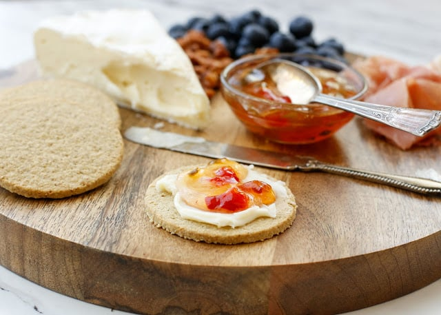 Savory oat crackers topped with creamy brie and sweetly spiced jam is a snack no one can resist! - get the recipe at barefeetinthekitchen.com