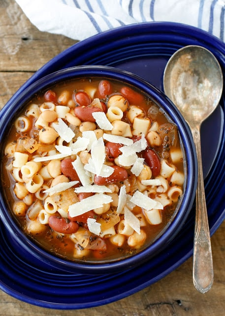 Pasta E Fagioli, or Pasta with Beans, is a classic Italian soup made with three different beans, pasta, and an abundance of Italian spices. Perfect for a casual weeknight supper or a dinner with friends, this is a hearty soup that just begs for some warm bread to sop up all the juices. - get the recipe at barefeetinthekitchen.com