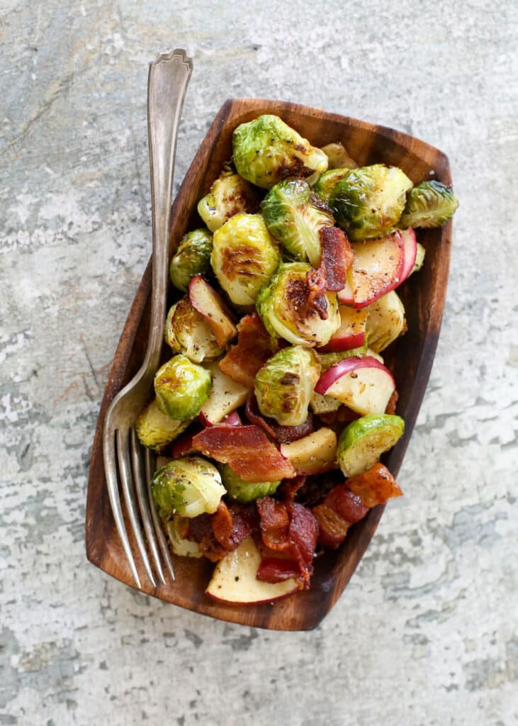 Salty bacon, sweet apples, and caramelized Brussels sprouts are combined in this outstanding side dish of Roasted Brussels Sprouts with Apples and Bacon.