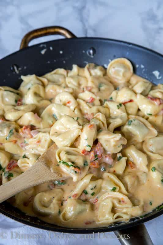 Tomato-Basil Pasta - a rich and creamy pasta dinner the whole family will love. Ravoili or Tortellini tossed in a sun-dried tomato cream sauce and plenty of fresh basil!