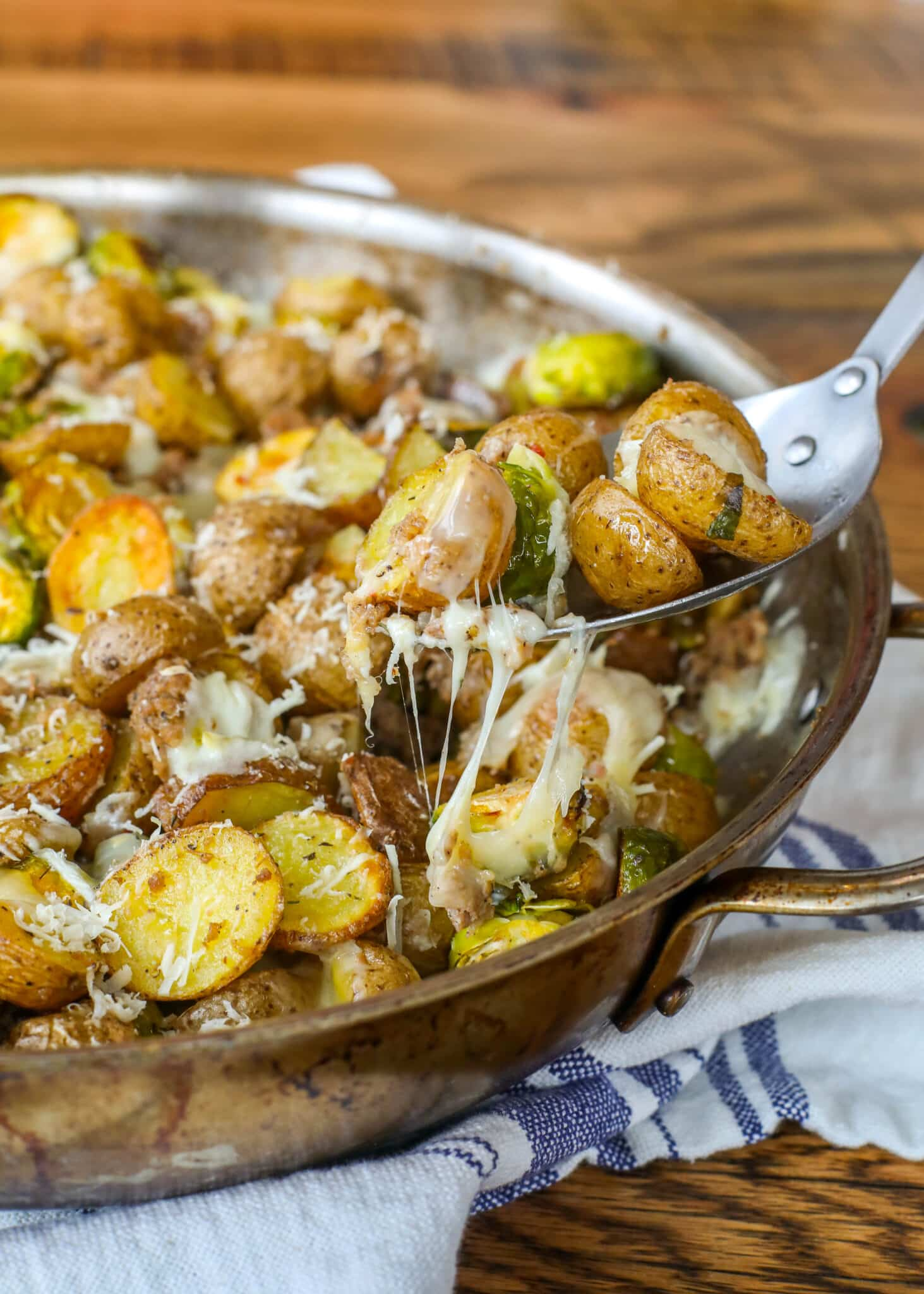 Potatoes + Brussels Sprouts + Sausage + Cheese adds up to one spectacular meal!