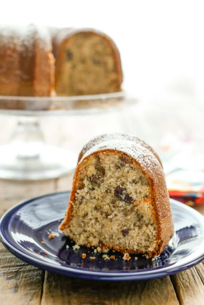 Wonder Cake is a tender, sweet cake, lightly spiced with cinnamon and nutmeg, filled with pecans and lightly sprinkled with powdered sugar! get the recipe at barefeetinthekitchen.com