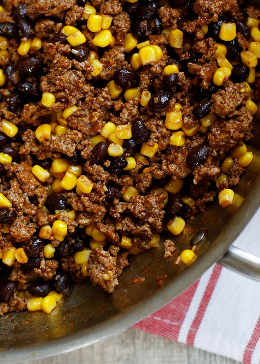 "The BEST Taco Meat starts with ground beef seasoned generously with Mexican spices is tossed with black beans and corn to create a versatile ""taco meat"" that is perfect for tacos, salads, burritos, quesadillas, and nachos."