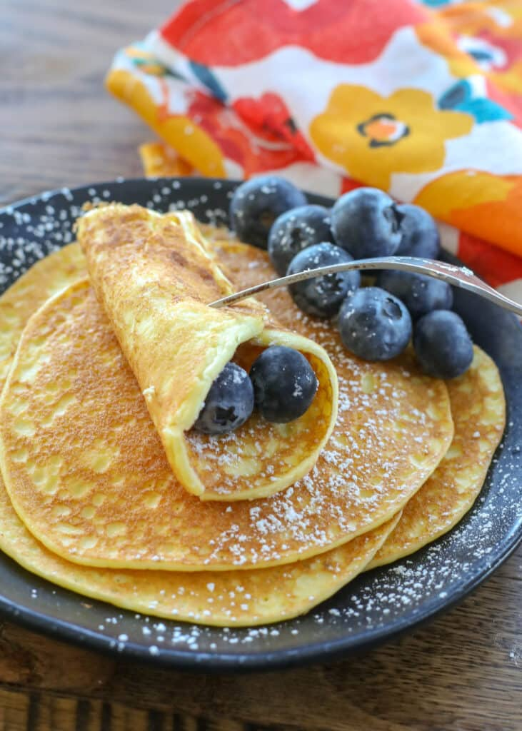 More crepe than traditional fluffy pancake, we love these delicate cream cheese pancakes!