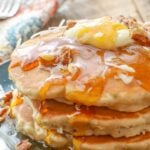 Banana, coconut, and pecans add up to a whole lot of deliciousness with these pancakes!