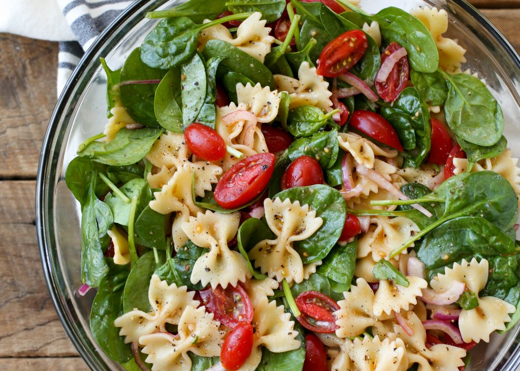 Spinach Pasta Salad is the perfect dinner on a warm summer night. Get the recipe at barefeetinthekitchen.com