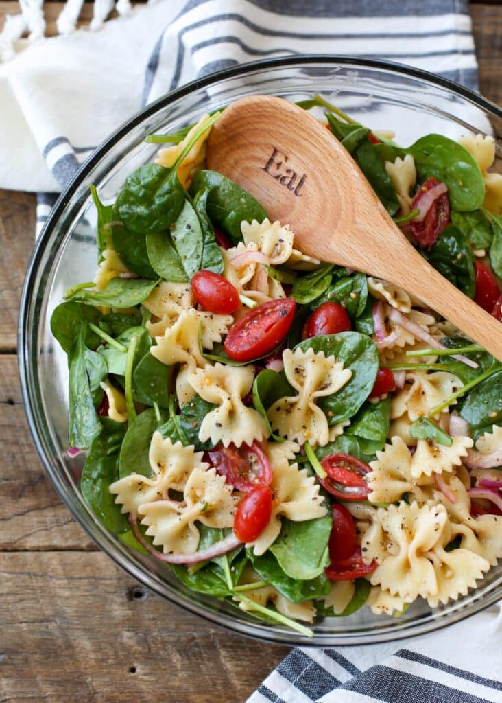 Spinach Pasta Salad is a summer favorite for easy lunches and dinners! get the recipe at barefeetinthekitchen.com