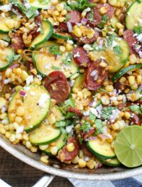 Skillet Mexican Street Corn with Squash and Kielbasa is a one-skillet dinner that comes together in no time at all. Get the recipe at barefeetinthekitchen.com