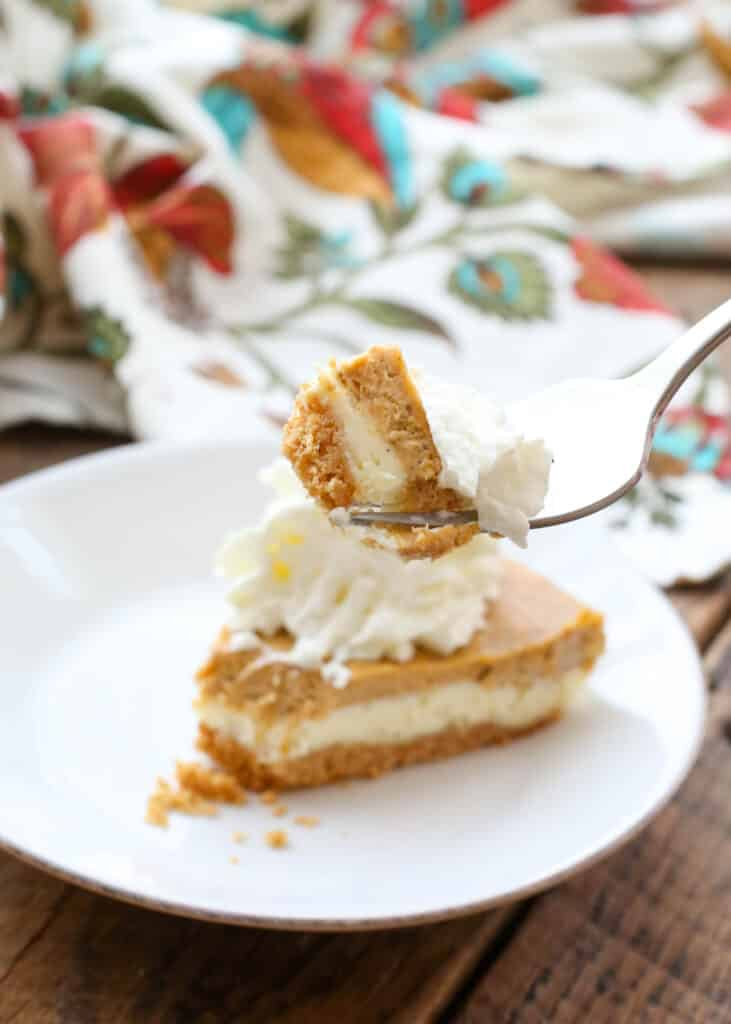 Layered Pumpkin Cheesecake Pie is a holiday favorite! get the recipe at barefeetinthekitchen.com