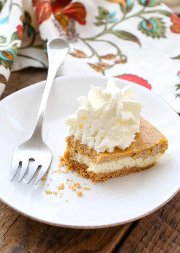 Pumpkin Cheesecake Layered Pie is a holiday favorite! get the recipe at barefeetinthekitchen.com