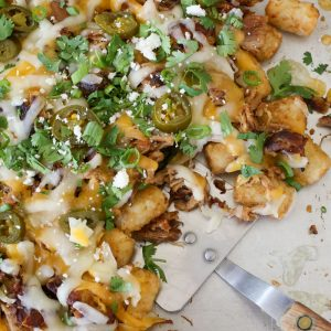 Pulled Pork Tater Tot Nachos disappear lightning fast! - get the recipe at barefeetinthekitchen.com