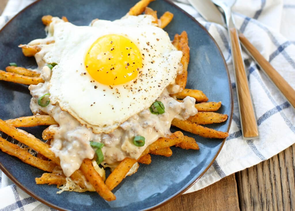 Breakfast Poutine is like no other poutine! get the recipe at barefeetinthekitchen.com