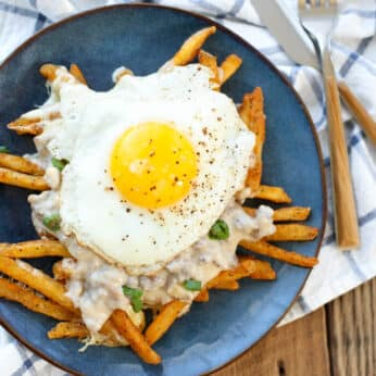 Crispy fries and melting cheese curds are topped with flavorful sausage gravy and an over-easy fried egg to make this Breakfast Poutine!