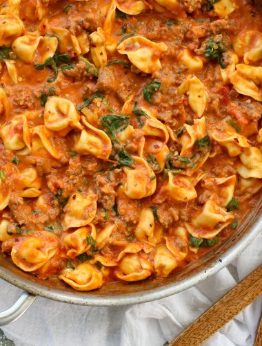 Sausage Tortellini Skillet with Creamy Tomato Sauce and Spinach is a kid and adult favorite. Get the recipe at barefeetinthekitchen.com