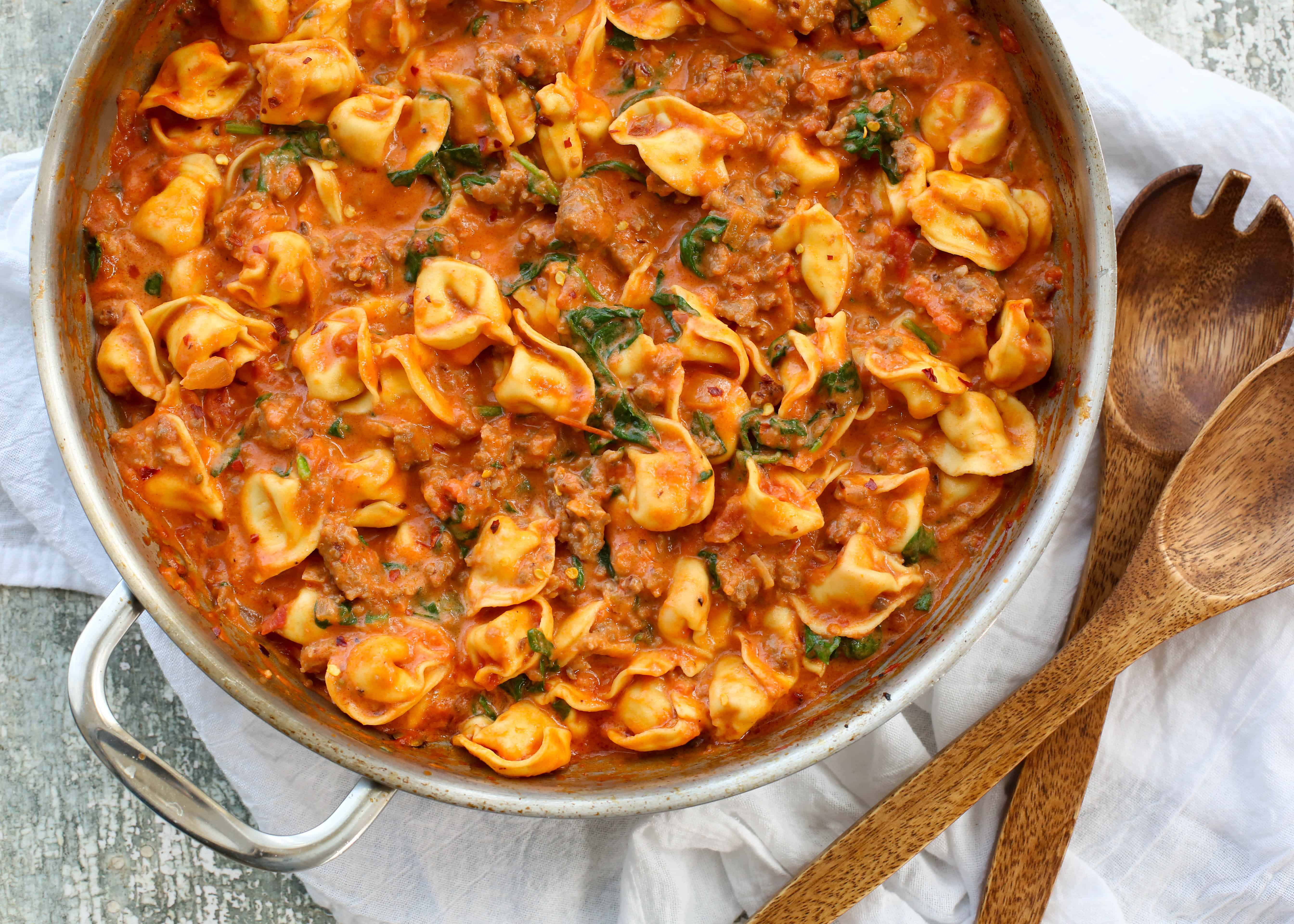 sausage tortellini and spinach in a creamy tomato sauce