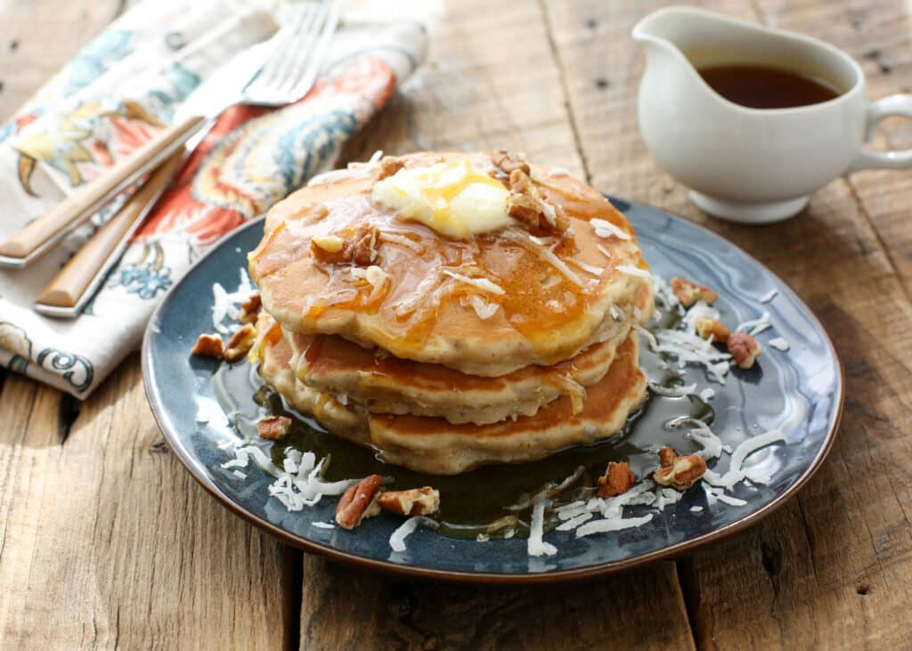 Banana Coconut Pecan Pancakes are a breakfast dream come true! get the recipe at barefeetinthekitchen.com