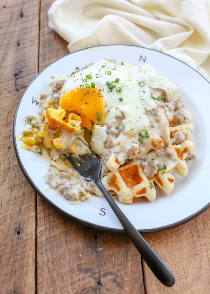 Cheddar Chive Waffles with Sausage Gravy are BETTER than Biscuits & Gravy! get the recipe at barefeetinthekitchen.com