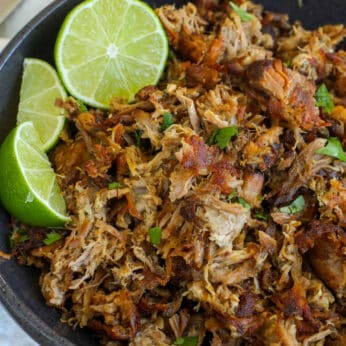 Pork Carnitas made in the crock-pot are a time saving way to get all that awesome carnitas flavor with a minimum of effort! - get the recipe at barefeetinthekitchen