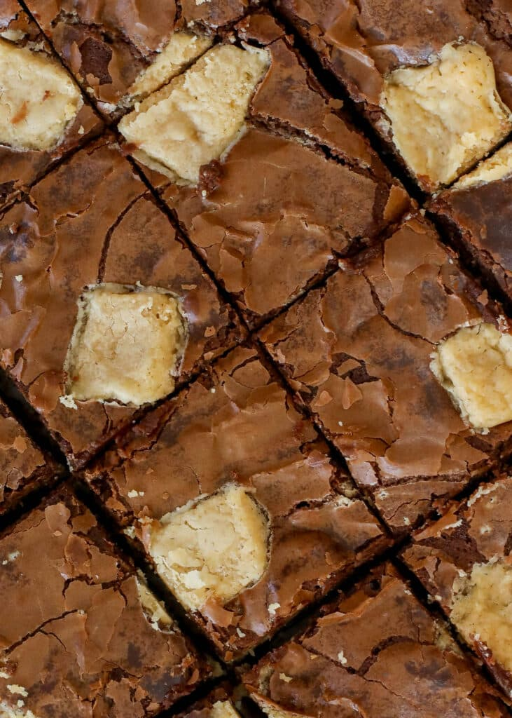 Rich chocolate brownies filled with chunks of creamy peanut butter fudge - get the recipe at barefeetinthekitchen.com