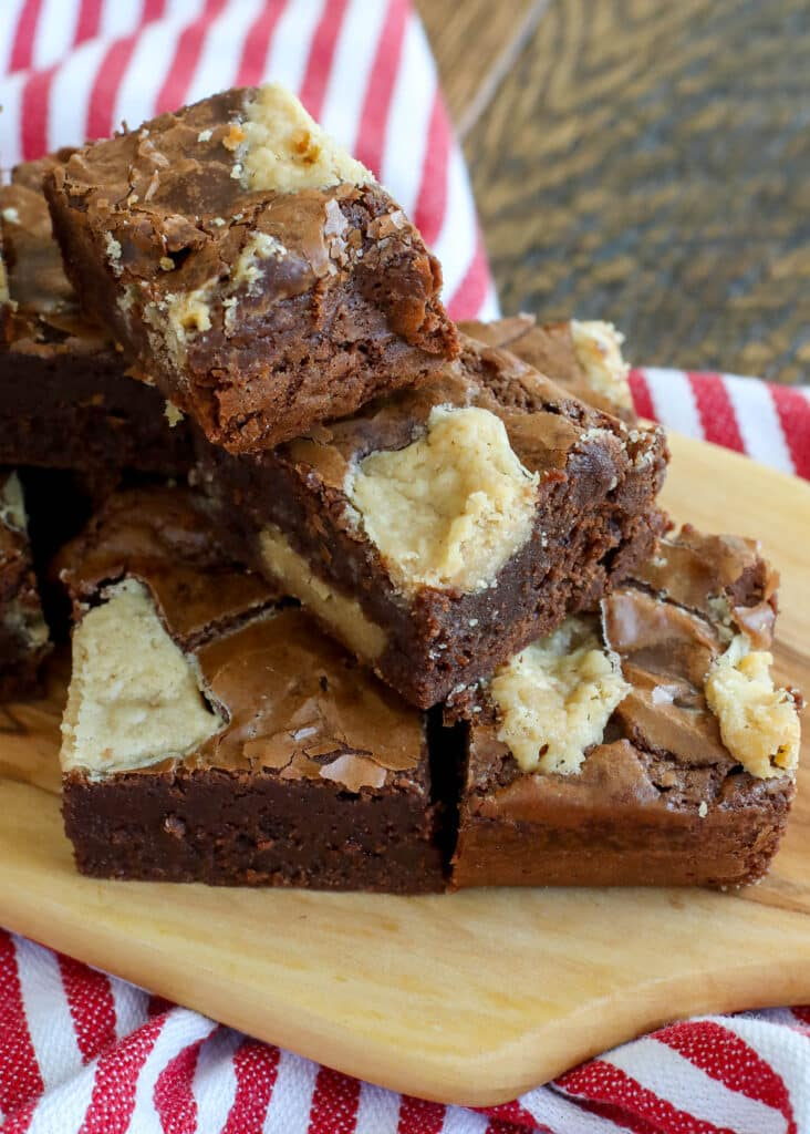 Rich brownies filled with chunks of peanut butter fudge at a hit! get the recipe at barefeetinthekitchen.com