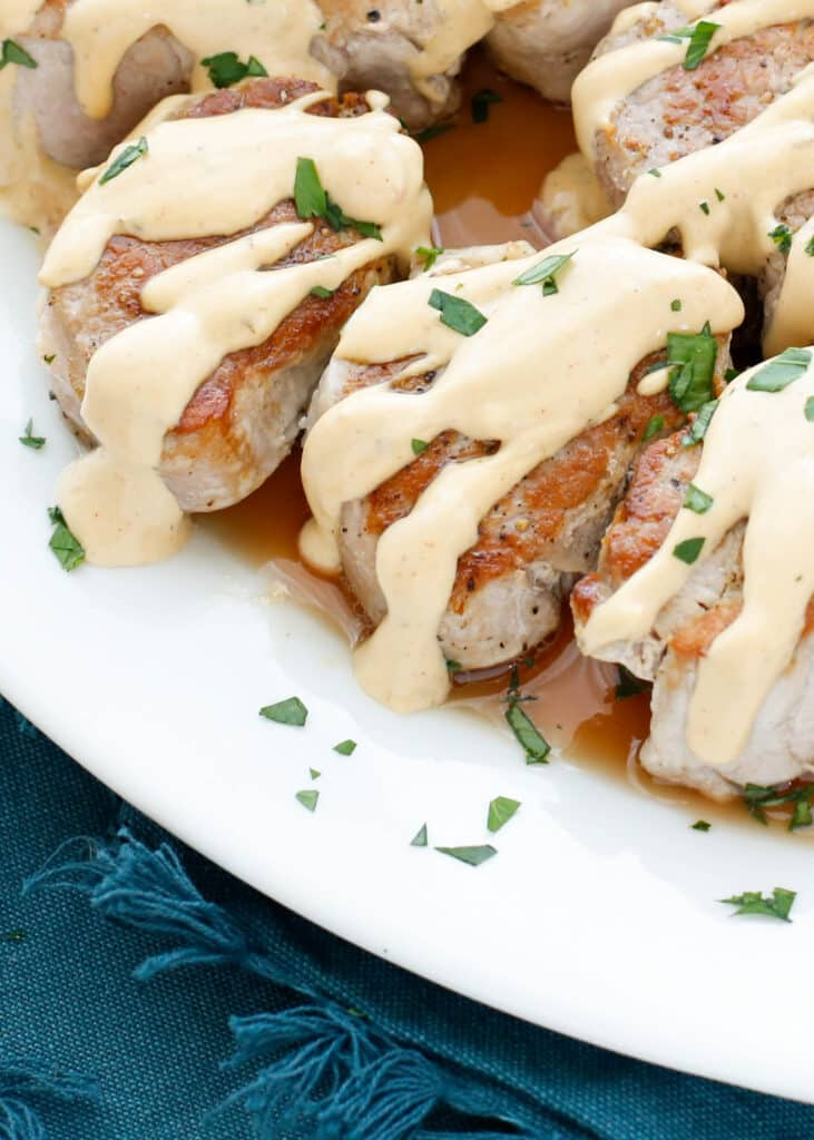 In just under 20 minutes, you can have these Pan Fried Pork Medallions in a Creamy Wine Sauce on the table! get the recipe at barefeetinthekitchen.com