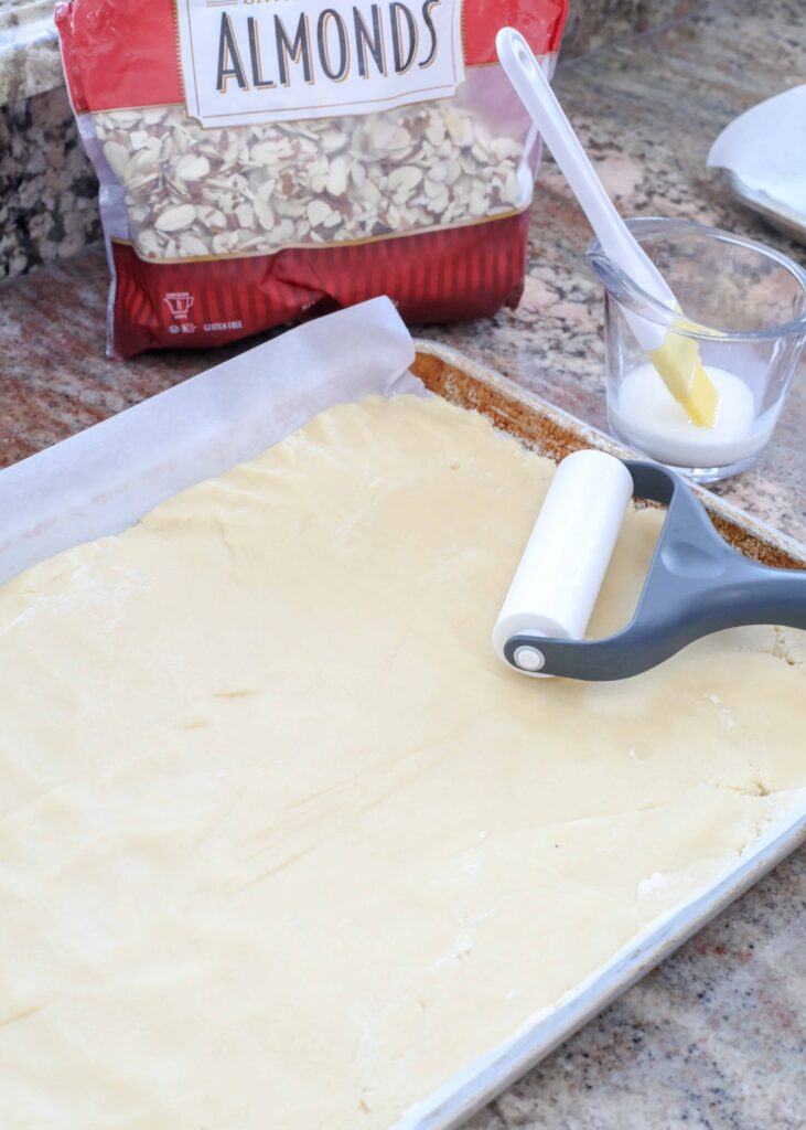 Almond bars ready for toppings before baking