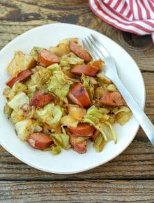 Cabbage and Sausage One-Pan Meal is a hearty dinner that everyone loves! get the recipe at barefeetinthekitchen.com