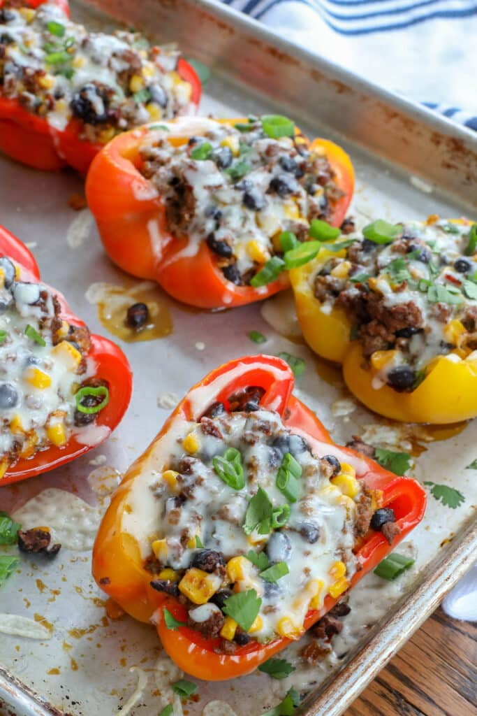 Spicy ground beef, black beans, and corn are tucked inside these Stuffed Peppers