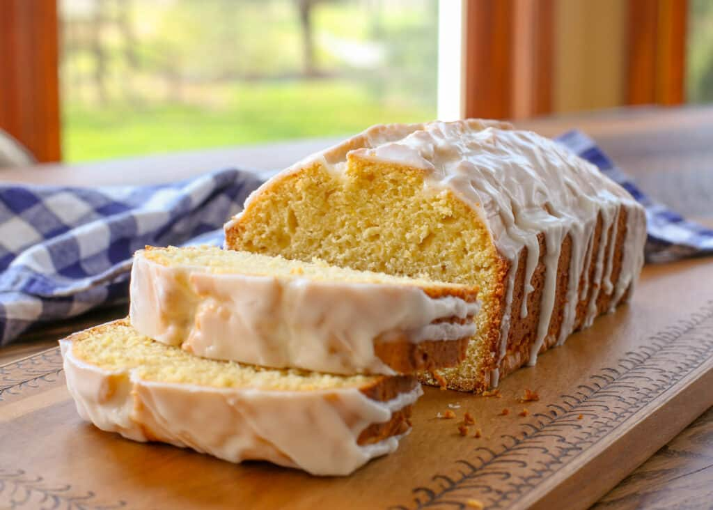 Iced Lemon Loaf Cake is wonderfully snackable and perfect with a cup of coffee or tea! get the recipe at barefeetinthekitchen.com
