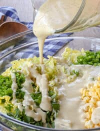 Jalapeno Corn Coleslaw is spicy and sweet with a perfectly creamy dressing! get the recipe at barefeetinthekitchen.com