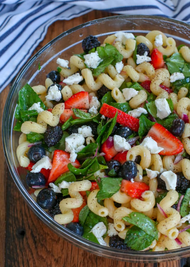Strawberry Spinach Pasta Salad with Goat Cheese and a light and tangy vinaigrette.