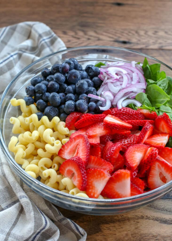 Strawberry Spinach Pasta Salad is light, sweet, and tangy - you're going to love it!