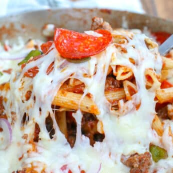 Cheesy Pizza Pasta Bake with pepperoni, sausage, peppers, mushrooms, and onions has our favorite supreme pizza flavors in an awesome bowl of pasta!