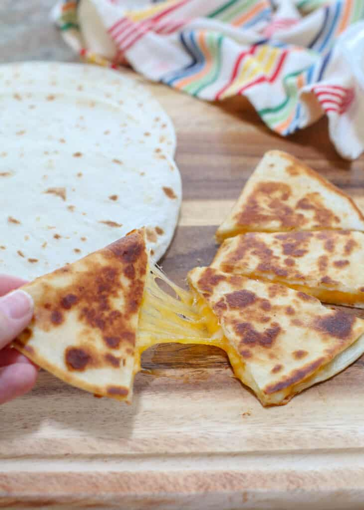 Quesadillas are a cheese filled favorite with everyone! find out how we make them at barefeetinthekitchen.com