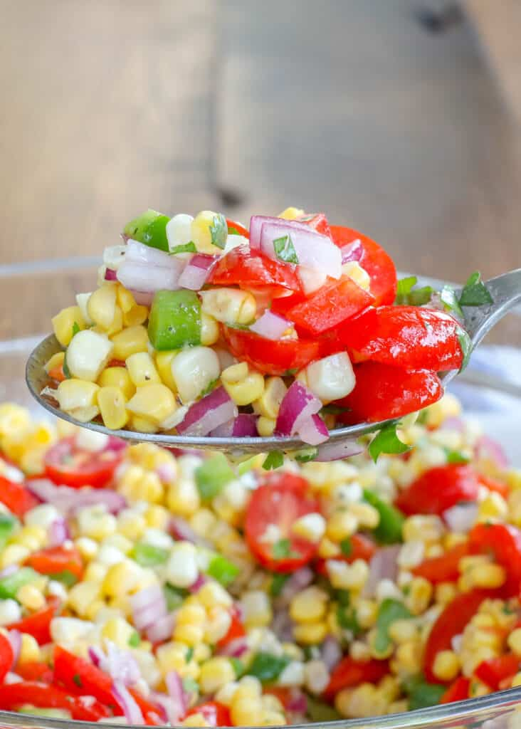 A tangy garlic and lime dressing is perfect on this Fresh Corn Salad