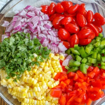 Summer Corn Salad with fresh corn, bell peppers, tomatoes, onion, and cilantro