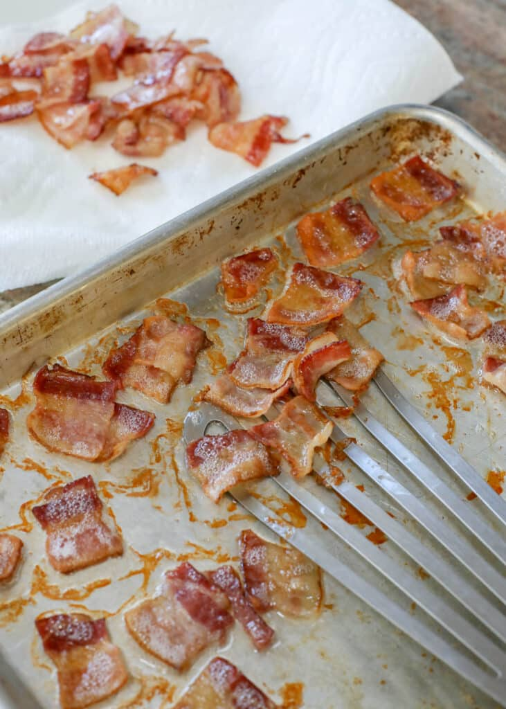Partially cooked bacon on roasting pan