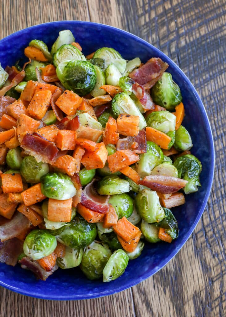 Roasted sweet potatoes with Brussels sprouts and bacon is a fantastic side dish for any meal