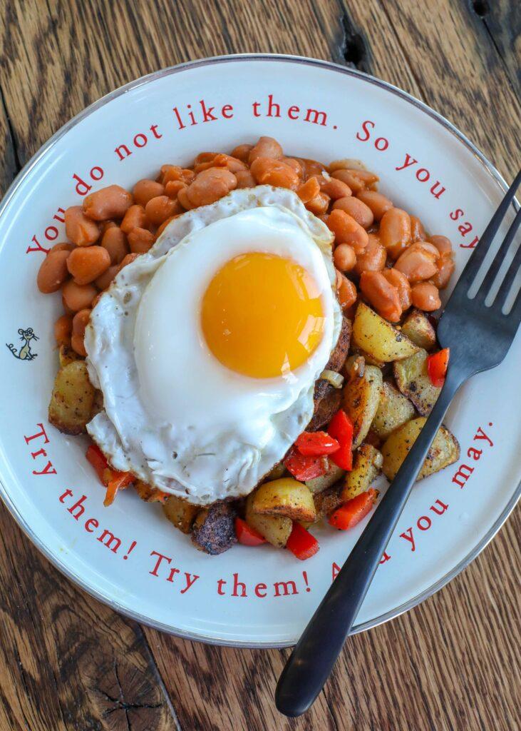 Huevos Rancheros with beans, potatoes, and salsa