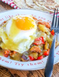 Huevos Rancheros with beans, potatoes, and plenty of green chile sauce