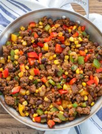 Taco Beef loaded with peppers, black beans, and corn adds up to a taco night we all love.